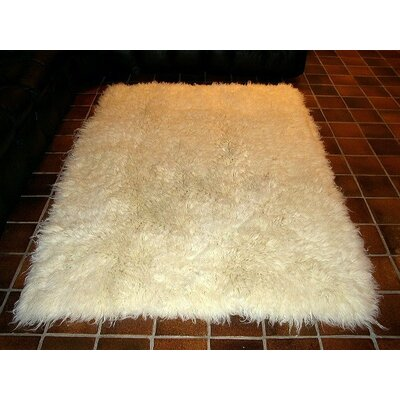 Hera Flokati Extra Natural White Solid Area Rug by IXI