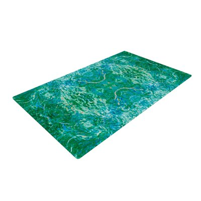 Eden Teal/Green Area Rug by KESS InHouse