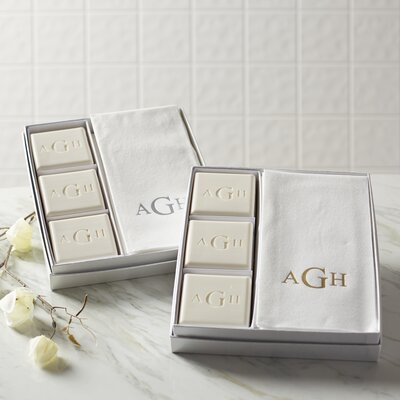 monogrammed towel and soap sets on the bathroom counter