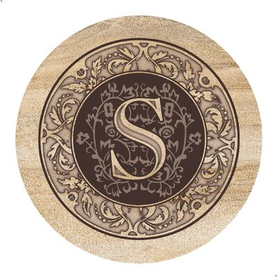 a wooden coaster monogrammed with the letter S