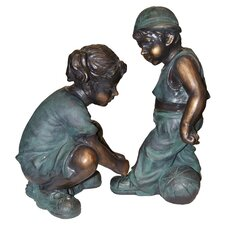 Girl Tying Boy's Shoe Statue