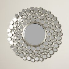Round mirrors are a stylish way to open up your home and liven up your wall décor. A round mirror is a perfect selection for your home if you would like to soften your space and bring in radiant light and unique textures. Our selection of round mirrors includes everything from frameless mirrors, large wall mirrors, and even beveled mirrors that can match the unique style of your home. Circular frames create eye-catching centerpieces that help to pull your creative design together. Round mirrors also create balance in different areas of your home. You can use circular mirrors of various sizes to create points of interest on your wall that attract attention and create a natural flow from one design element to another. You can use a singular circular mirror or a cluster of circular mirrors together to create an art piece on your wall.