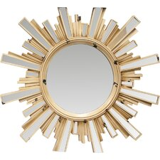 Sunburst Mirrors If you are looking for room decorating ideas, then a sunburst mirror is a great addition to your living room wall décor. Incorporating a sunburst mirror into your interior design is a great way to lighten up your home. The sunburst mirror, which is also known as a starburst mirror, is an iconic decorating piece that is said to have been popularized under King Louis XIV of France, who chose the sun as his iconic emblem. The mirror is recognized by its iconic sunburst design. A circular mirror is surrounded by a sunburst shape, including lines that extend outward from the center of the circle. You can use sunburst mirrors as decorative mirrors for your wall, mantle, or you can even place them over your headboard. Sunburst mirrors come in all styles and sizes and can fit your unique personality.