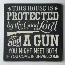 'This House Is Protected By A Gun' Wall Decor